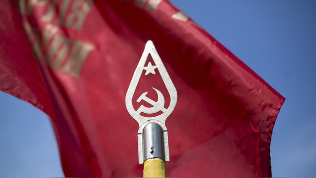 Soviet symbols are pictured during an International Worker's Day, or Labour Day, parade in the town of Slaviansk