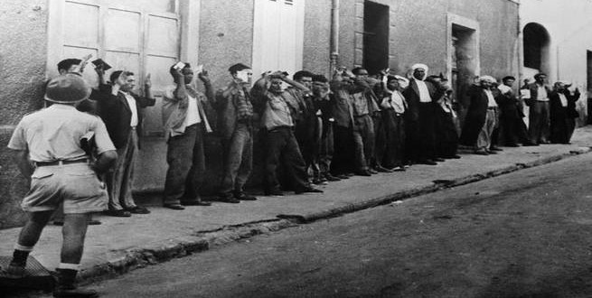 Unknown, Algiers, Algeria --- The French army verifies the identity of Algerian citizens in the streets of Algiers during the War of Independence. --- Image by © Archives Barrat-Bartoll/Corbis