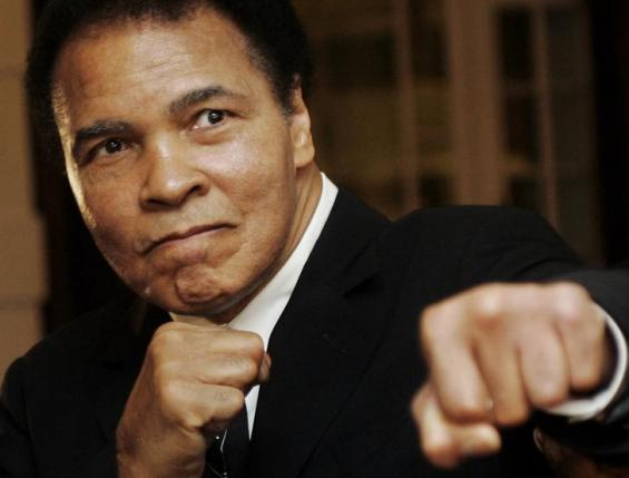 Muhammad Ali poses during the World Economic Forum in Davos, Switzerland. REUTERS/Andreas Meier