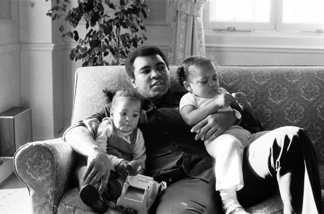 Muhammad Ali cuddling his daughters Laila, (L)and Hana at a hotel in London, December 1978.    Action Images/MSI