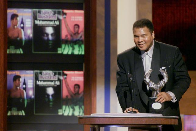 Boxing Legend Muhammad Ali speaks to the audience after accepting the Athlete of the Century award at the Sports Illustrated 20th Century Sports Awards at New York's Madison Square Garden, in this December 2, 1999 file photo. REUTERS/Mike Segar/File Photo