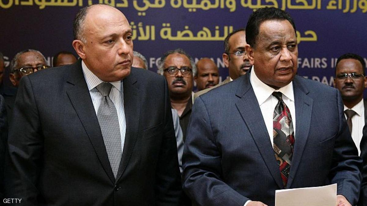Egyptian Foreign Minister Sameh Shoukri (L), Sudanese Foreign Minister Ibrahim Ghandour (C) and Ethiopian Foreign Minister Tedros Adhanom (R) pose for a group picture after reaching an agreement following another round of talks on the Grand Ethiopian Renaissance Dam (GERD) project that has strained ties between Cairo and Addis Ababa in the Sudanese capital Khartoum on December 29, 2015. Egypt, Ethiopia and Sudan signed a declaration of principles in Khartoum setting guidelines for resolving disagreements related to Ethiopias Grand Renaissance Dam project, the three countries set a period of 8-12 months for technical studies of the operation mechanisms and consequences of constructing the dam, which Cairo and Khartoum fear will diminish their water share of the Nile River. AFP PHOTO / EBRAHIM HAMID / AFP / EBRAHIM HAMID        (Photo credit should read EBRAHIM HAMID/AFP/Getty Images)