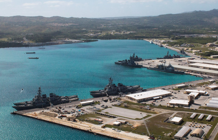 FILE PHOTO: Navy vessels are moored in port at the U.S. Naval Base Guam at Apra Harbor, Guam March 5, 2016.  Major Jeff Landis,USMC (Ret.)/Naval Base Guam/Handout/File Photo via REUTERS. ATTENTION EDITORS - THIS IMAGE WAS PROVIDED BY A THIRD PARTY - RTS1AYM8