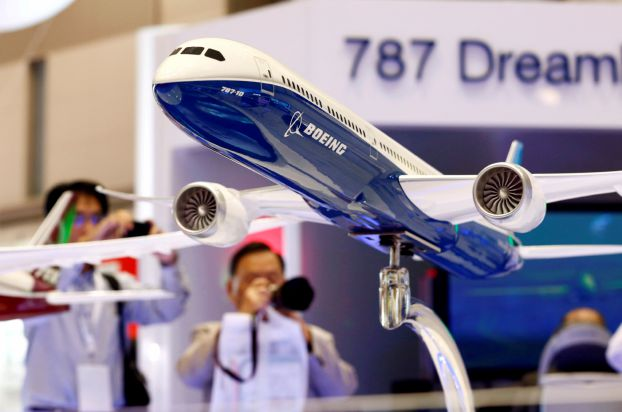 FILE PHOTO: Visitors take pictures of a model of Boeing's 787 Dreamliner during Japan Aerospace 2016 air show in Tokyo, Japan, October 12, 2016.   REUTERS/Kim Kyung-Hoon/File Photo - RC18EDD572A0