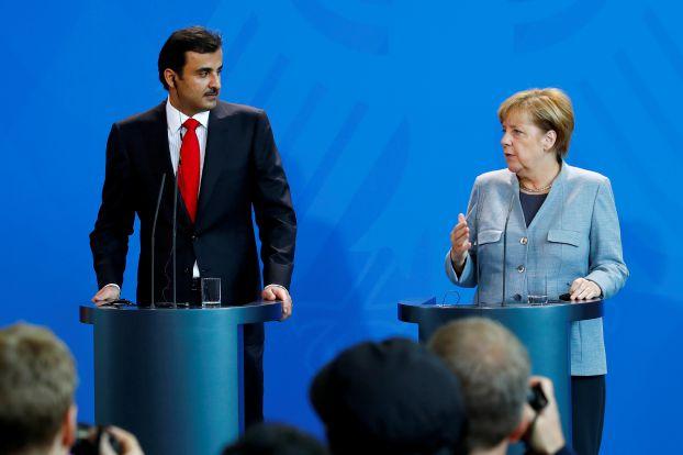 German Chancellor Angela Merkel and Qatar Emir Sheikh Tamim bin Hamad al-Thani attend a news conference in Berlin, Germany, September 15, 2017. REUTERS/Axel Schmidt