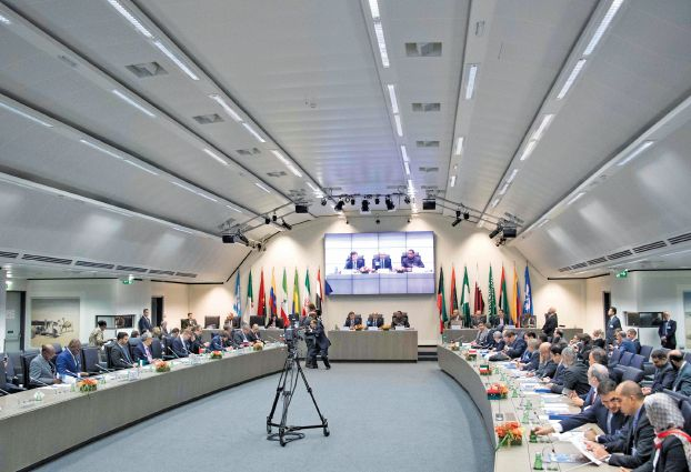 OPEC ministers attend the Organization of the Petroleum Exporting Countries (OPEC) meeting in Vienna, on September 22, 2017 where the OPEC members reviewed progress on their 2016 agreement to curb oil output. / AFP / JOE KLAMAR